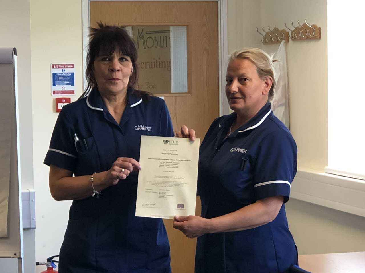 Two nurses with their certificate